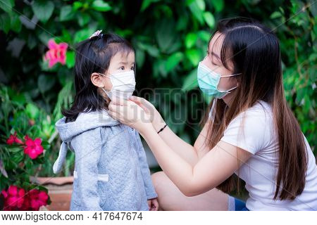 Prevent Spread Of Coronavirus And Pm2.5 Toxic Dust, Air Pollution Problem Concept. Mom Wearing Medic