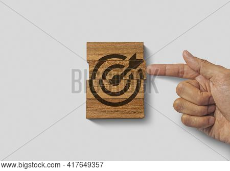 Hand Putting The Last Piece Of Wooden Blocks With The Dart Target Icon On White Background. Goal, Bu