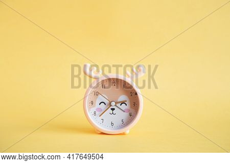 Bright Juicy Photo Of Children's Table Clock In The Form Of A Deer In Yellow Color On A Yellow Backg