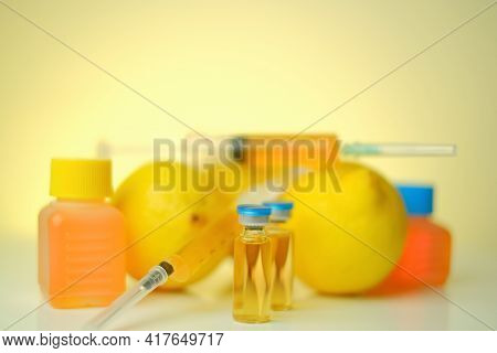 Vitamin C In Ampoules. Solution For Injection. Health And Beauty.organic Cosmetics Concept.syringes,