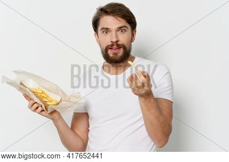 Man With Beard Holding Fries And High-calorie Food Happy Look Model