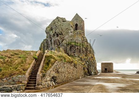 Saint Helier Hermitage Site With Medieval Chapel On Top With German Ww2 Bunker In The Background, Ba