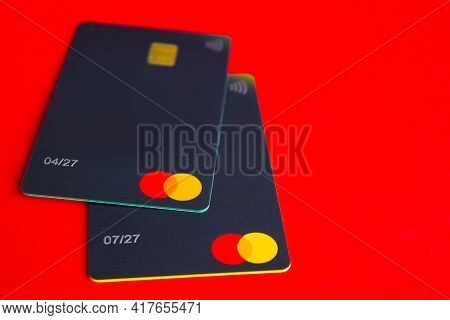 Kyiv, Ukraine - April 18, 2021: Mastercard Credit Card Close Up On Red Background