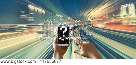Question Marks With Person Using A Smartphone Over Abstract High Speed Technology Pov Motion Blur