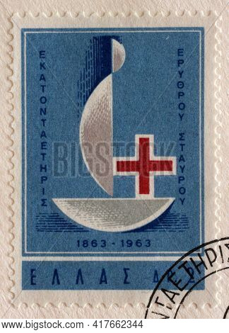 ZAGREB, CROATIA - SEPTEMBER 13, 2014: Stamp printed by Greece shows Red Cross - Centenary Emblem, International Red Cross series, circa 1963