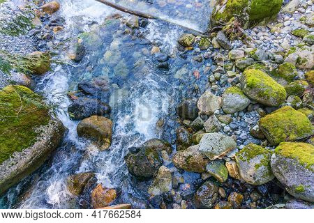 Clear Water Flows Over And By Rocks In Denny Creek In Washington State.