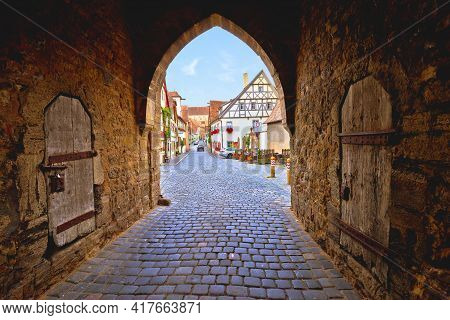 Idyllic German Cobbled Street. Tower Gate Passage And Street Architecture Of Medieval German Town Of
