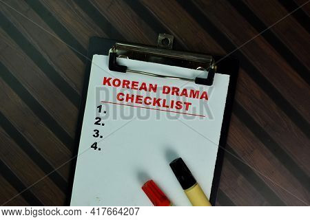 Korean Drama Checklist Write On A Paperwork And Supported By Additional Services Isolated On Wooden