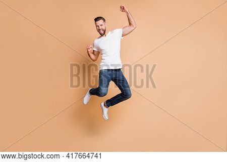 Full Length Body Size View Of Nice Tall Cheerful Macho Guy Jumping Rejoicing Having Fun Isolated Ove