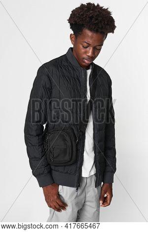 African American boy in black nano puff jacket winter apparel shoot