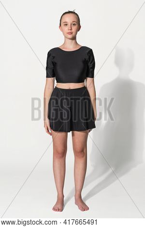 Teen girl in black two-pieces black swimsuit for summer apparels shoot