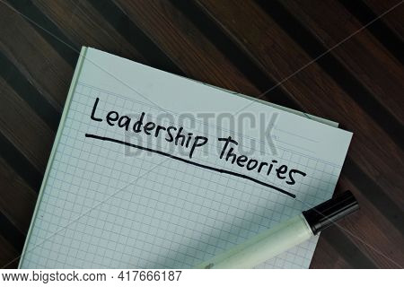 Leadership Theories Write On A Book Isolated On Wooden Table.