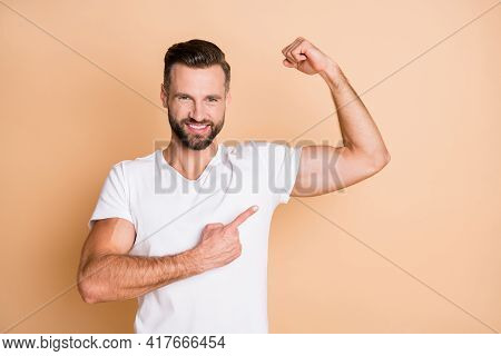 Photo Of Young Handsome Sportsman Happy Positive Smile Point Finger Biceps Advert Choice Isolated Ov