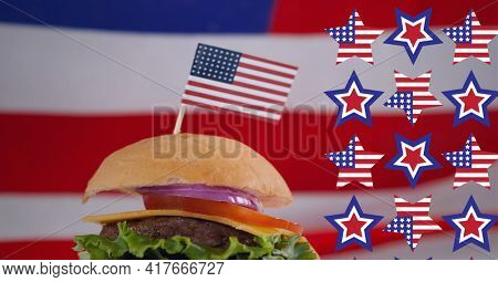 Composition of american flag stars with hamburger and american flag. american patriotism, food and culture concept digitally generated image.
