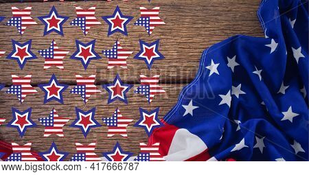 Composition of american flag stars over american flag on wooden surface. american patriotism, culture and tradition concept digitally generated image.