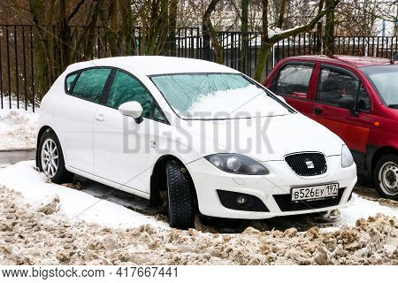 Moscow, Russia - January 24, 2021: White Hatchback Seat Leon In The City Street.