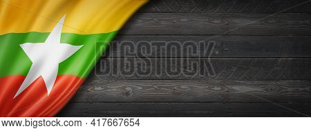 Burma Myanmar Flag On Black Wood Wall. Horizontal Panoramic Banner. 3d Illustration