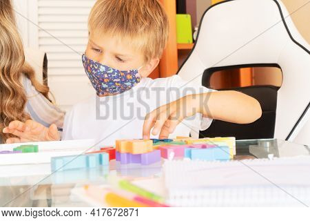 Back To School, Calss Rom With And Student Collecting Puzzles Together Wearing Protective Masks, Qua