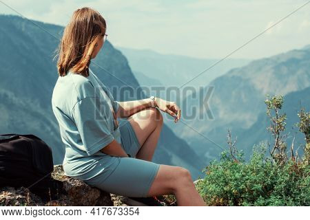 Woman on the top of Altai mountain, Katu Yaryk mountain pass and the valley of the river of Chulyshman, beauty summer day landcape. Travel, leisure and freedom concept