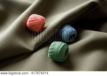 Abstract Background, Curved Dark Beautiful Fabric And Coils With Different Colored Threads, Copy Spa