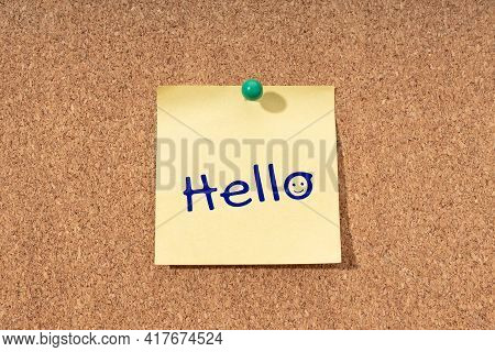 Hello Word On Yellow Note On Cork Board