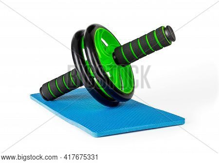 Ab Wheel On Blue Knee Pad Isolated On White Background. Ab Trainer For Abdominal Muscles Exercises.