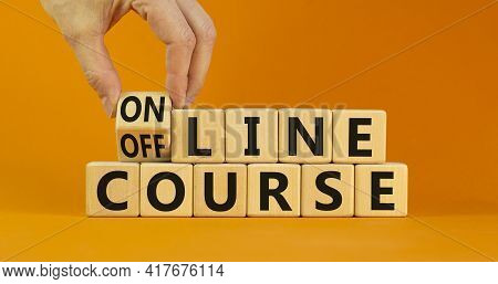 Online Or Offline Course Symbol. Businessman Turns The Cube, Changes Words 'offline Course' To 'onli