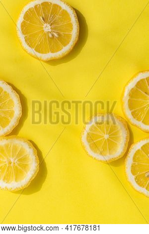 Lemons On A Yellow Background . Sliced Lemon. Yellow Fruit. Lemon Copy Space Layout . Yellow Backgro