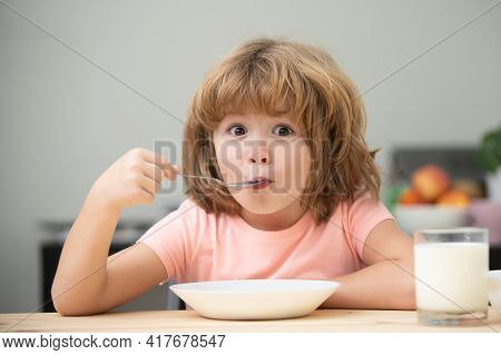 Caucasian Toddler Child Boy Eating Healthy Soup In The Kitchen. Healthy Nutrition For Kids. Child Nu