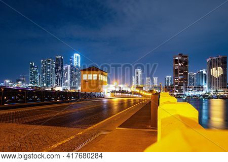 Miami Florida, Sunset Panorama With Colorful Illuminated Business And Residential Buildings And Brid