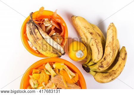 Using Spoiled Fruits And Other Organic Kitchen Waste In Bowls, On White Background.