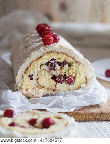 Meringue Roll Cake With Cream And Fresh Cranberries. Roulade, Summer Dessert. Vertical Orientation,