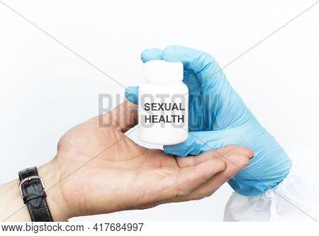 Sexual Health The Inscription On The Jar Which The Doctor Passes Into The Patient's Hand. Medical Co