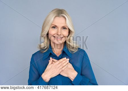 Happy Smiling Mature 50 Years Old Woman Looking At Camera Feeling Sincere Gratitude. Portrait Of Gra