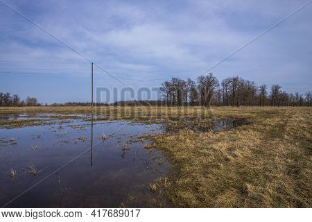 Evening Landscape With A River. Village And Forest On The Horizon. Sunset On The River. The Sky And
