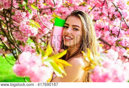 Smiling Girl With Nature Herbal Cosmetic. Shampoo Or Conditioner. Luxury Cosmetics. Haircare, Beauty