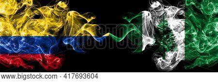 Colombia, Colombian Vs Australia, Australian, Norfolk Island Smoky Mystic Flags Placed Side By Side.