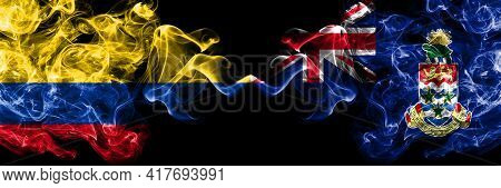 Colombia, Colombian Vs British, Britain, Cayman Islands Smoky Mystic Flags Placed Side By Side. Thic