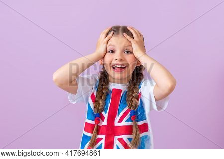 A Girl With An Image Of The English Flag On A T-shirt Is Very Happy To Learn English.