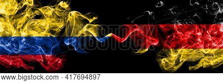 Colombia, Colombian Vs Germany, German, Deutschland Smoky Mystic Flags Placed Side By Side. Thick Co