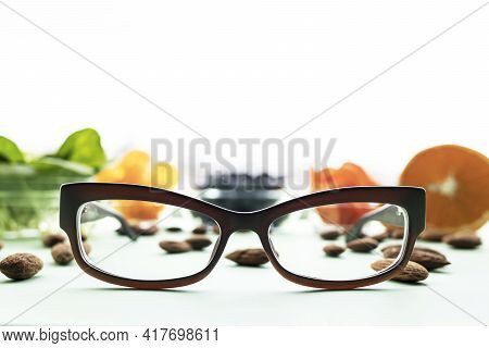 Modern Fashionable Corrective Optical  Glasses Close-up Against The Background Of That Improve Visio