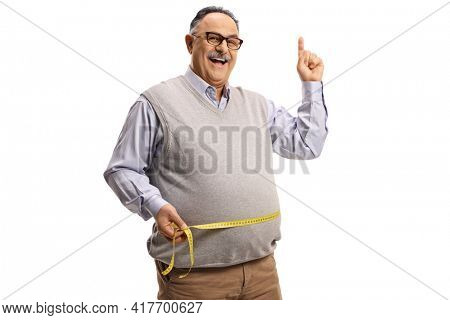 Mature man measuring his waist with a tape and pointing up isolated on white background