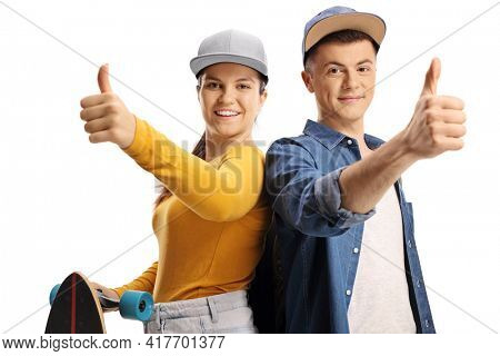 Young people with a longboard showing thumbs up isolated on white background