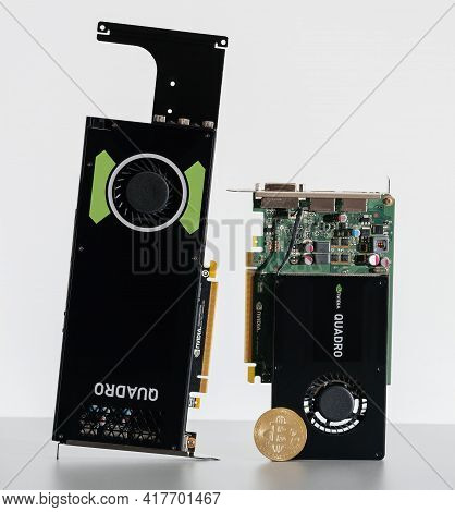 Paris, France - Aug 23, 2017: Detail Of Ngold Bitcoin Coin And New Professional Nvidia Quadro K2200