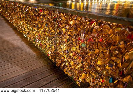 Paris, France, 1.11.2019 - Thousands Golden Love Locks On Pedestrian Bridge Ponts Des Arts, Symbol O