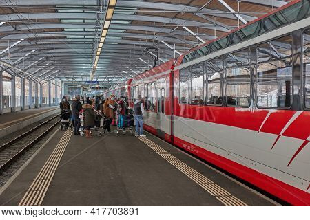 Tasch, Switzerland - Circa 2021: Train on Zermatt Shuttle line in the Swiss Alps arriving to the station. This famous mountain resort town is not accesible by car for ecological reasons.