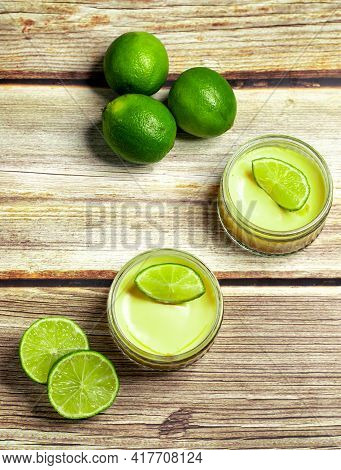 Lime Cheesecake Desserts Served With Fresh Limes