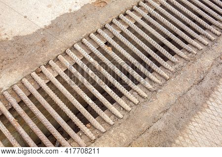 Drainage Channel With A Grate Made Of Iron Rods Fittings Dirty In Clay, Industrial Wastewater Infras