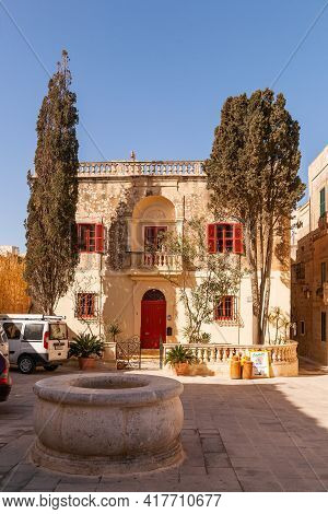Mdina, Malta - February 18, 2010. Beautiful Antique Building With Red Old Fashioned Shutters In Mdin