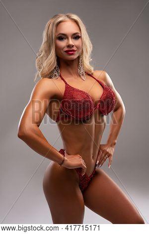 Powerful Blond Female Model In Glittering Bikini